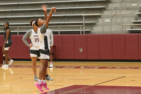 Senior power forward Wynter Taylor (25) watches senior shooting guard Kaiya Braggs (13) shoot a ball from the free-throw line during practice on Thursday, Dec. 13.