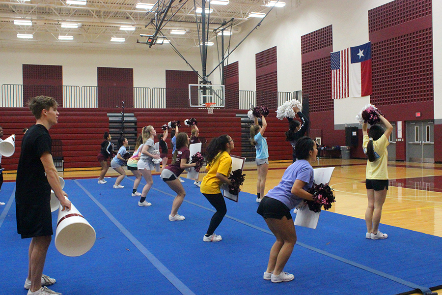 The varsity cheer team practices their routine for nationals during a third period practice on Friday, Jan. 25.