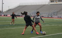 Junior Michelle Cortez and sophomore Mia Espinoza practice  during third period on Tuesday, Jan. 17.