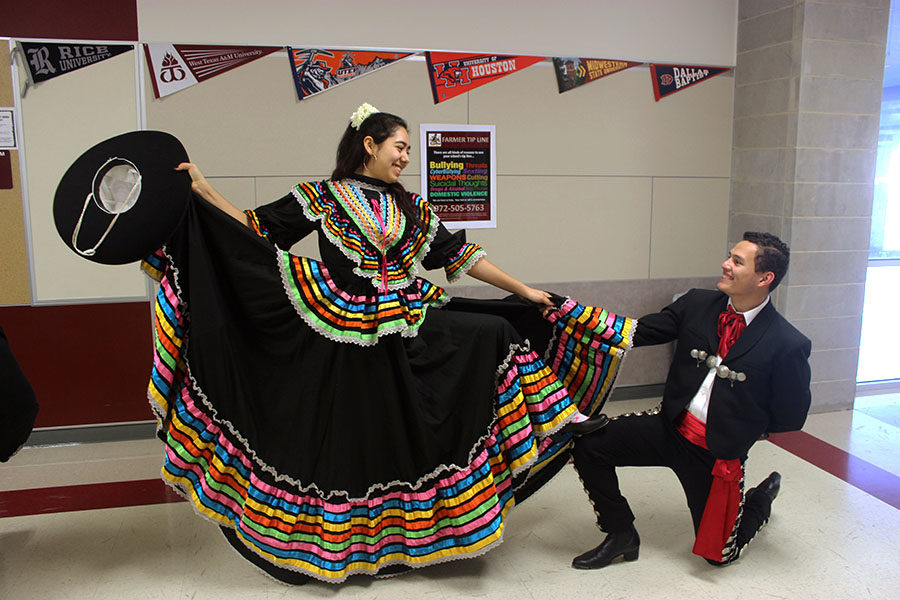 Senior Anna Martinez looks down at senior David Saravia as they finish dancing during practice after school on Tuesday, Jan. 29.