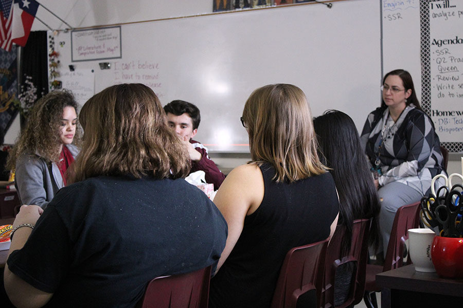 Students from lit mag listen to a peers poem during B-block on Thursday, Feb. 7.