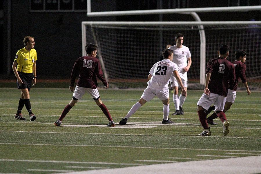 Varsity boys play against Marcus for the goal.