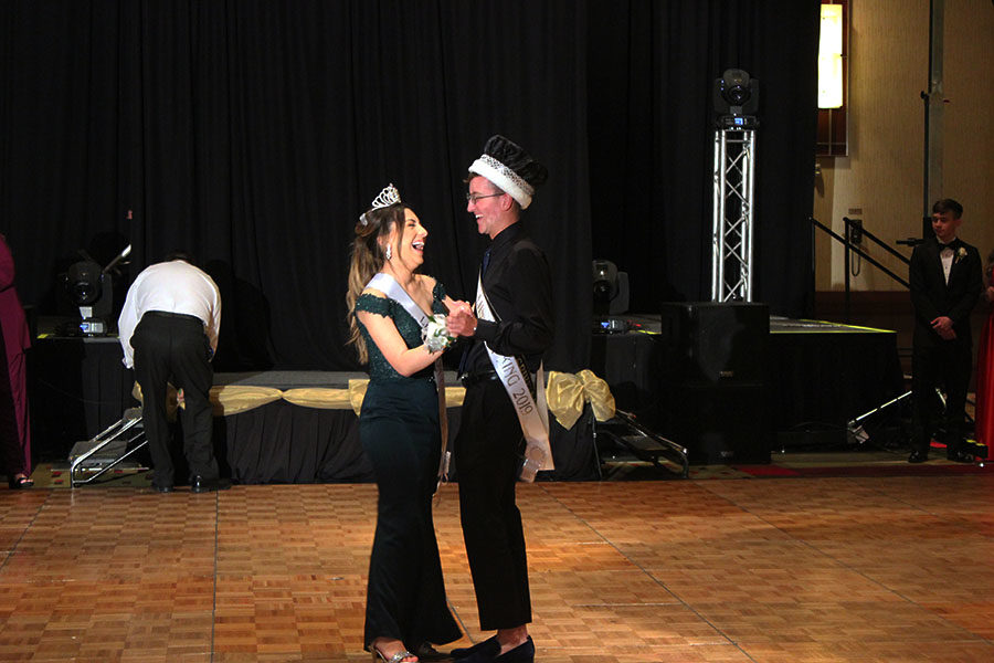 Seniors Prom King and Queen Wesley Brewer and Jackie Hernandez laugh as they dance to