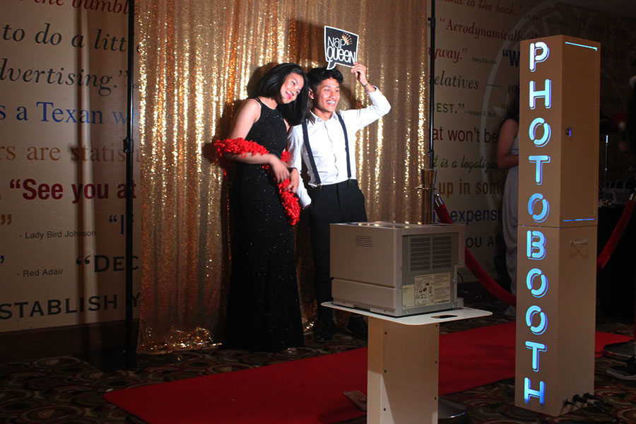 Students take a photo at the provided photo booth.