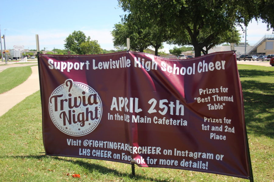 A sign is displayed at the entrance of the school to attract more attendees to cheers trivia night on Thursday, April 25.