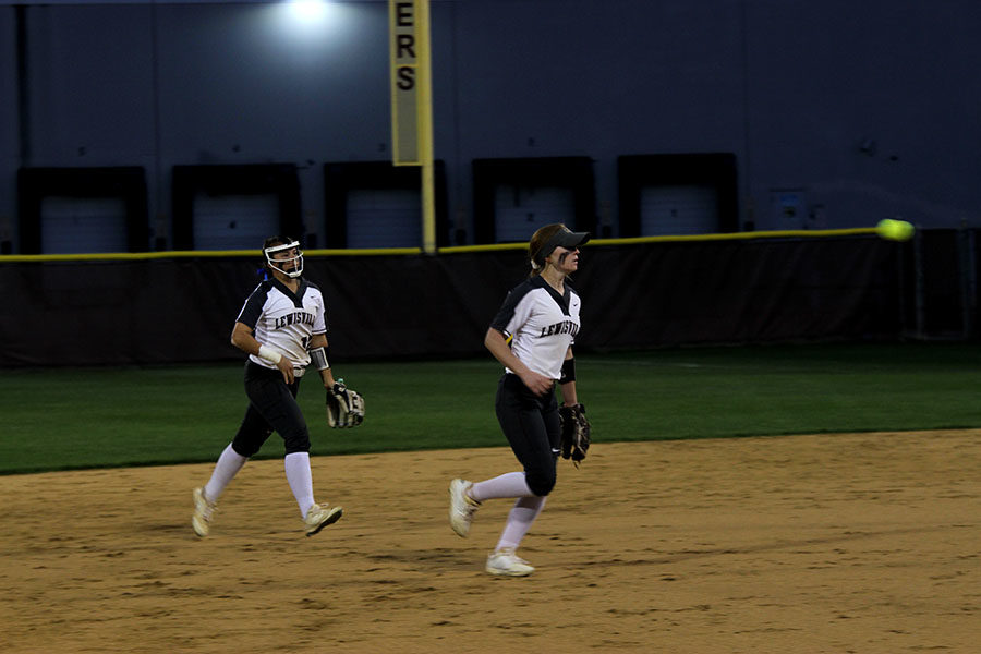 Junior Emma Dollak and sophomore Emilee Till run back to their team.