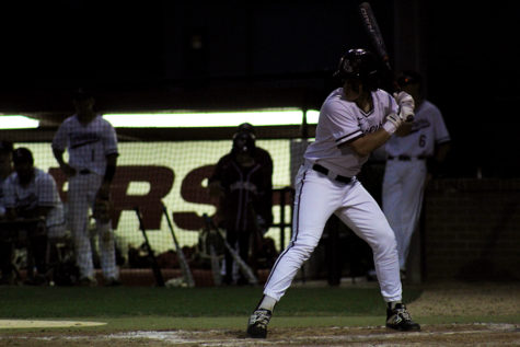Senior Caleb Vuono (9) prepares to swing his bat at the home game against Hebron on Tuesday, April 16.