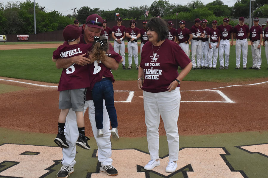 Baseball+head+coach+Mike+Campbell+celebrates+his+45-year+career+in+coaching+before+the+home+game+against+Hebron+on+Tuesday%2C+April+12.