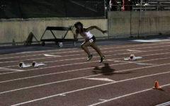 Junior captain Sierra Beal runs during the district meet last weekend. Courtesy of Sierra Beal.