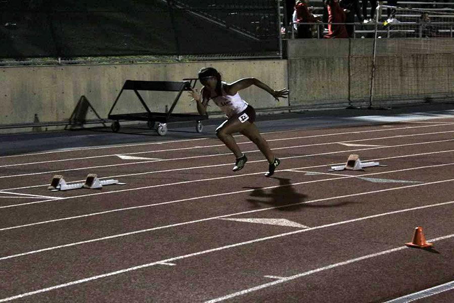 Junior+captain+Sierra+Beal+runs+during+the+district+meet+last+weekend.+Courtesy+of+Sierra+Beal.