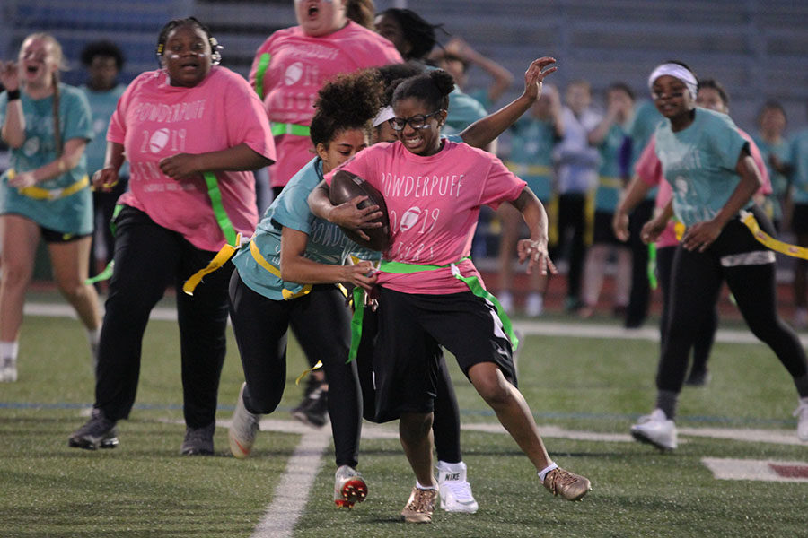 Senior Alexandra Jackson tries to run with the ball from junior Vyviene Spaulding.