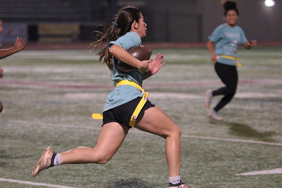 Junior America Elizalde runs with the ball.