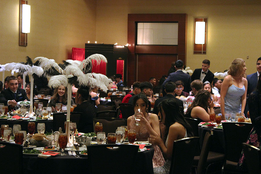 Students gather with their friends, waiting for the main course.