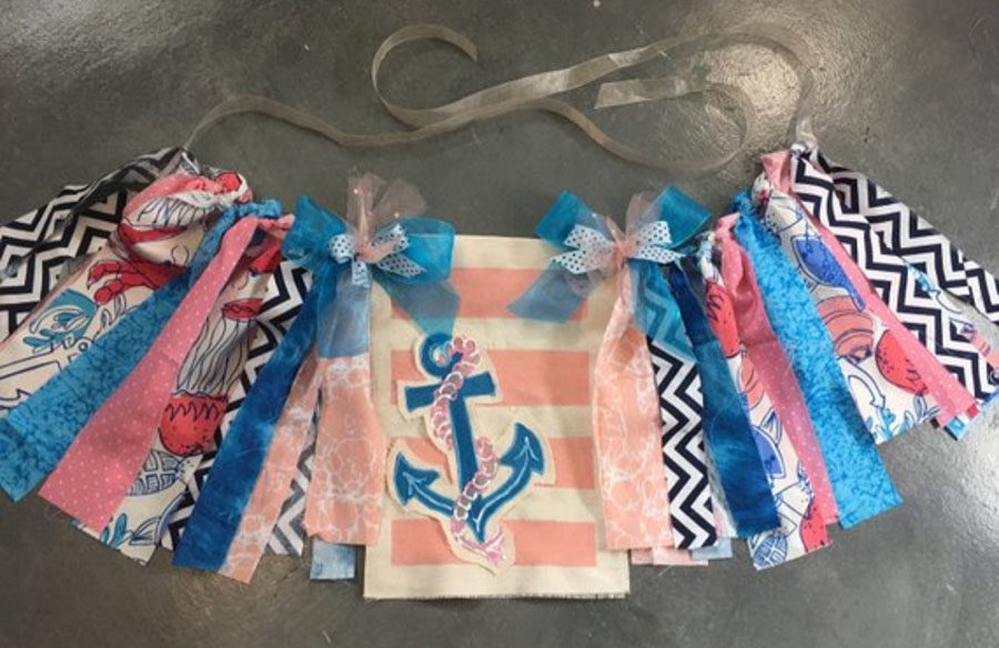 One of art teacher Shanna Blair's creations, an anchor nautical high chair banner, is for sale on her Etsy account for $20.