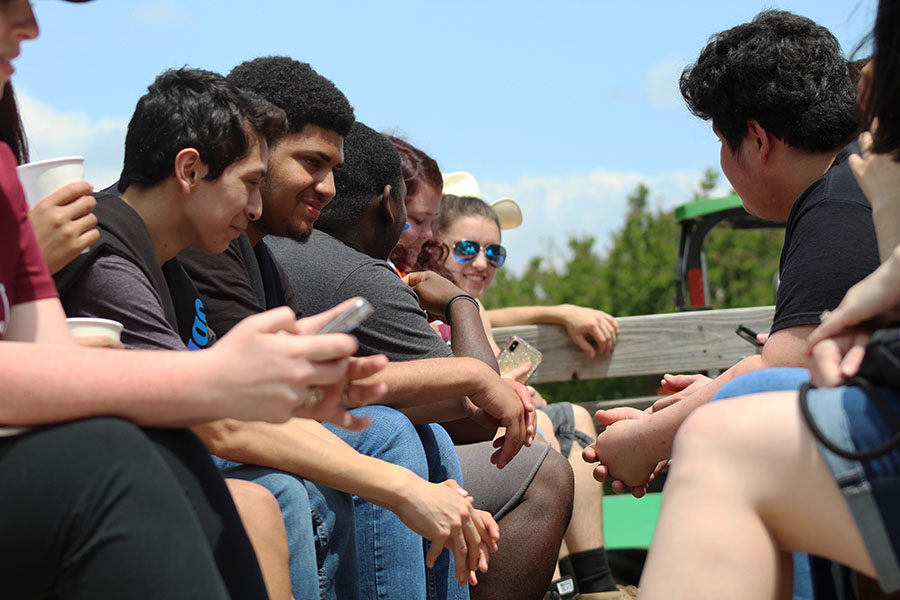 Seniors sit on the wagon ride as it starts to move.