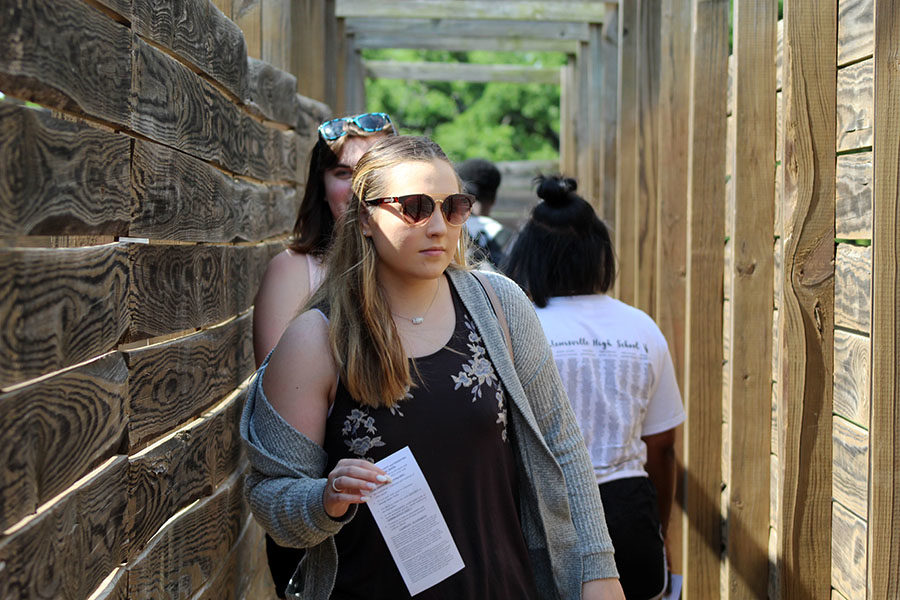 Senior Bealey Cook walks through the maze, trying to find the letters.