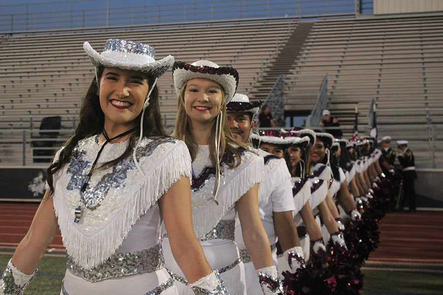The Farmerettes line up behind senior captain Taylor Dill.