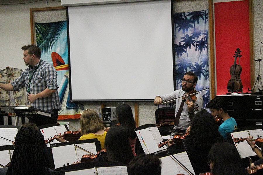 Orchestra directors Richard Greenwood and James Zauner co-direct a class.