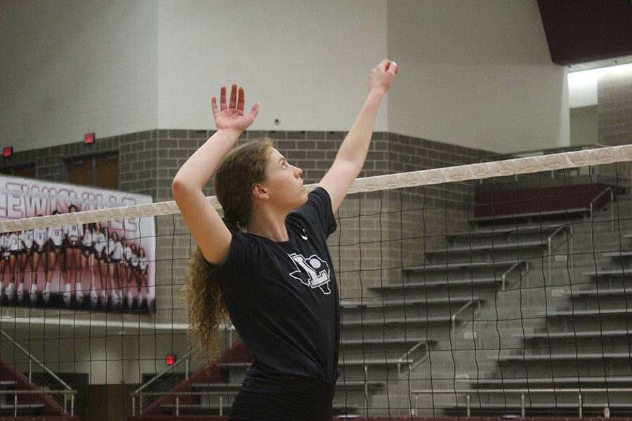 Senior Emerson Coburn rehearses the motions of an attack during practice on Thursday, Sept. 19.