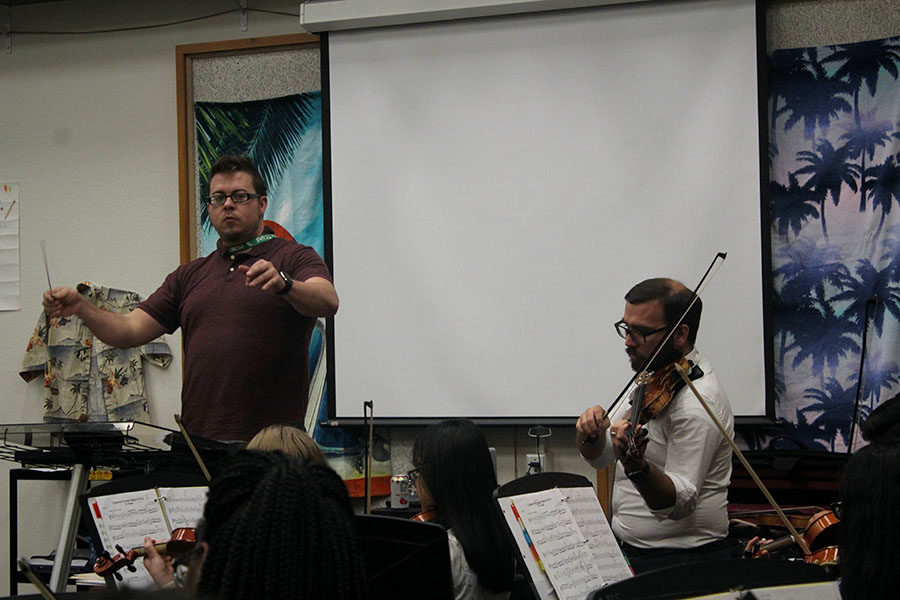 Orchestra directors Richard Greenwood and James Zauner co-direct during third period on Tuesday, Sept. 17.