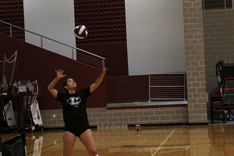 Senior captain Audrey Rodriguez serves the ball at varsity practice during first period on Friday, Sept. 6.
