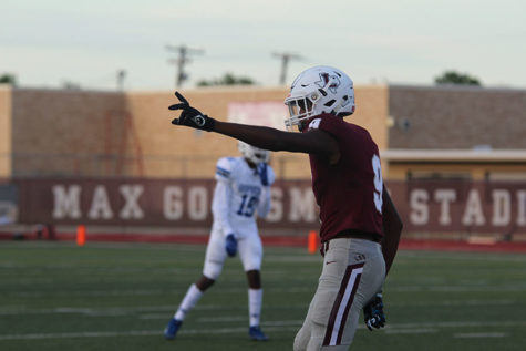 Sophomore wide receiver Armani Winfield (9) raises his hand before the play begins at the home game against Grand Prairie on Friday, Aug. 30.