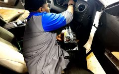 Senior Avante Bond fixes an airbag at Sam Pack's Five Star Ford Lewisville on Thursday, Feb. 13.