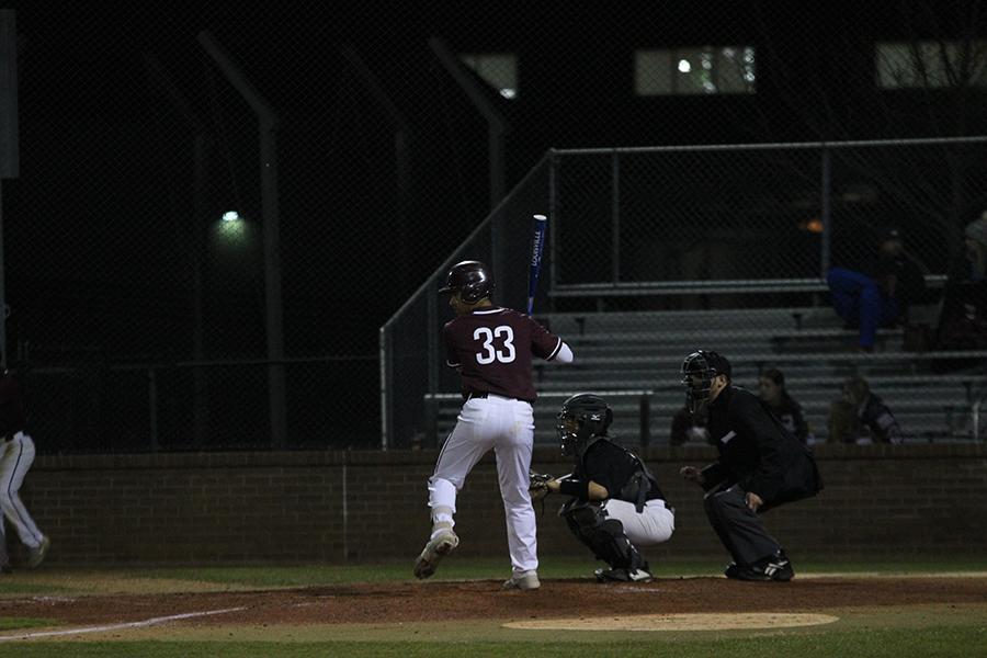 Senior Jimmy Bolton (33) readies a swing.