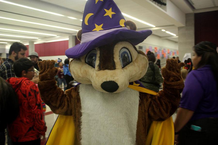 The Smile Magic mascot dances at the Halloween carnival.
