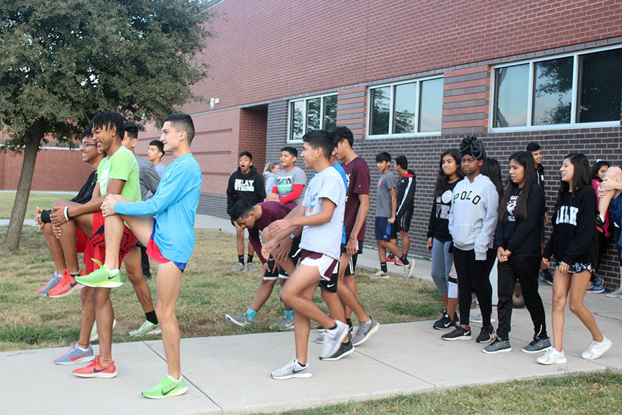 The cross country team warms up during practice before school on Thursday, Oct. 17.