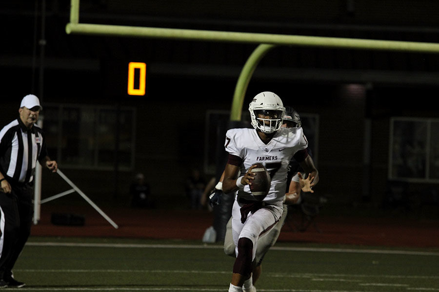 Junior quarterback Taylen Green (17) runs the ball down the field at the home game against Flower Mound on Friday, Sept. 27.