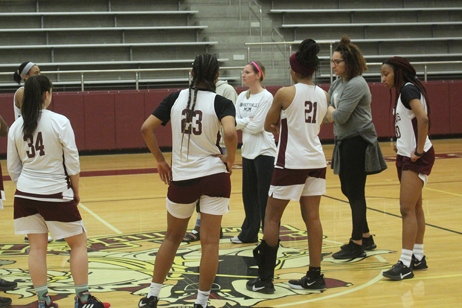Juniors Kaitlyn Blair, Eryka Patton, Laila Lawrence, Haley Allen and the rest of the team listen to a speech given by head coach Sally Allsbrook during practice on Wednesday, Feb. 19.