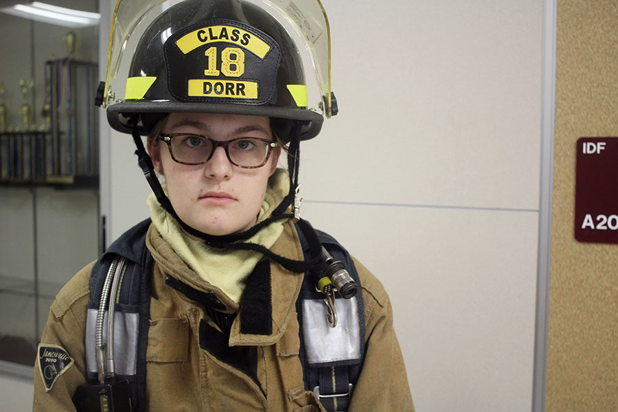 Senior Haley Dorr dons her firefighting gear before school on Tuesday, Oct. 22.