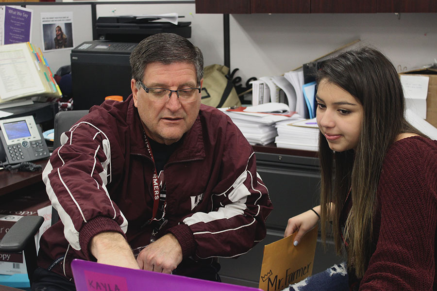 StuCo adviser Dan Moser speaks with senior class president Kayla Rios.