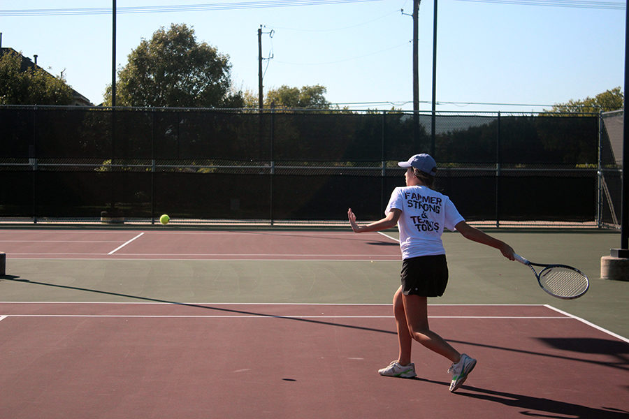 Senior Meara Kelleher prepares to return the ball with a forehand