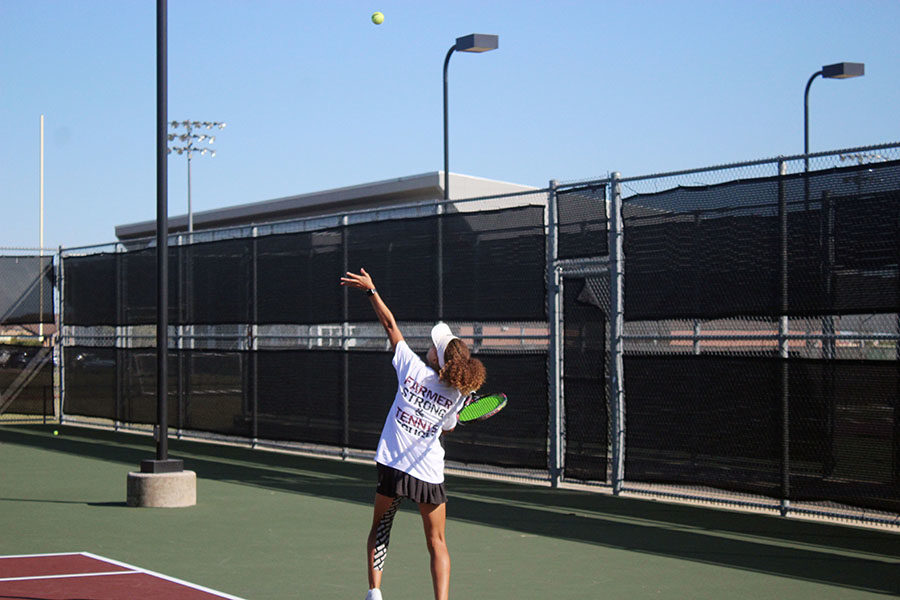Sophomore Amber Rhodes serves the ball during fourth period tennis practice on Tuesday, Oct. 8.