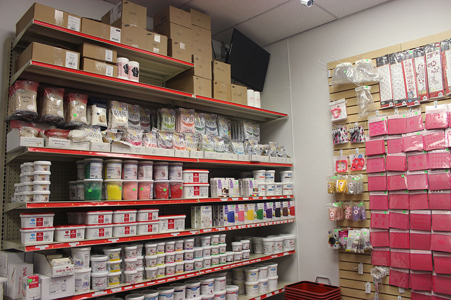 The back corner of the store has shelves filled with sugar paste, candy melts, stencils and more.