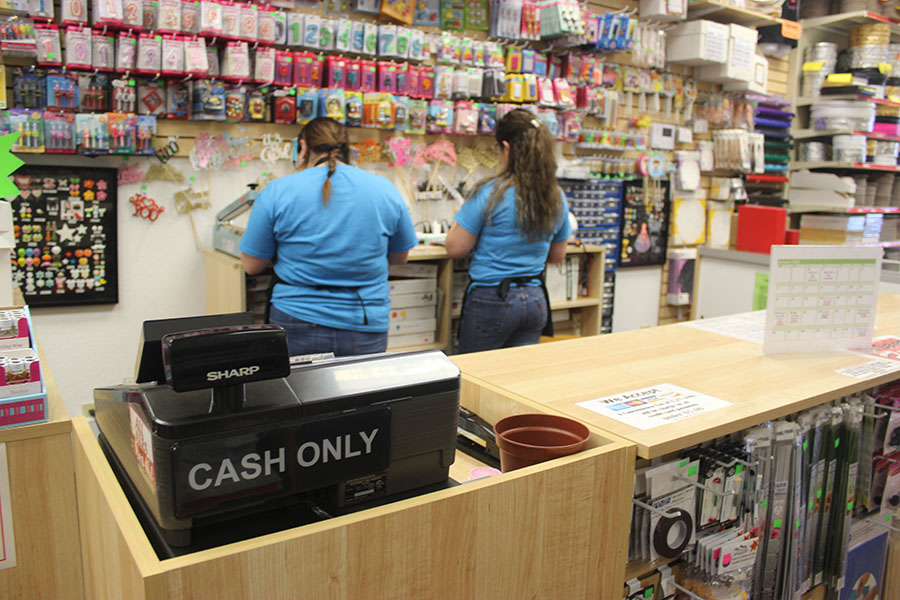 Employees make sure everything is running smoothly at the front of the store.