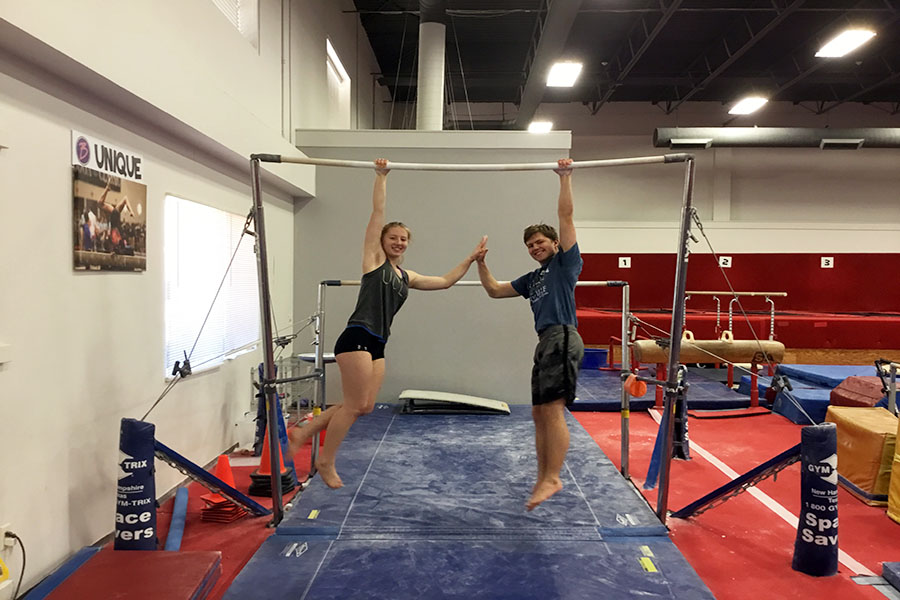 Freshman Jessica Alspaugh and senior Chris Alspaugh practice bars together at Best Gymnastics on Tuesday, Nov. 12.