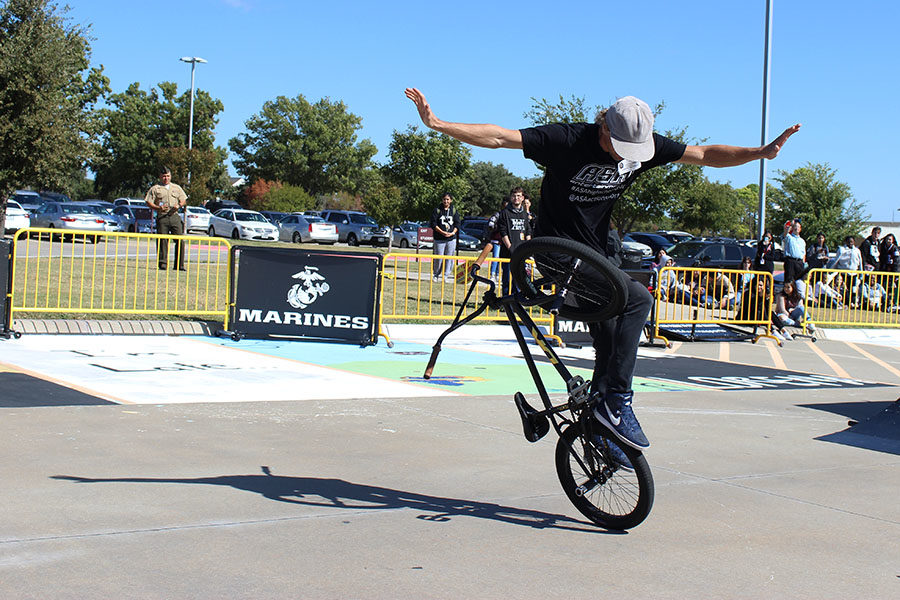 Dane Beardsley uses the bike peg and rear wheel to balance on the bike with no hands.