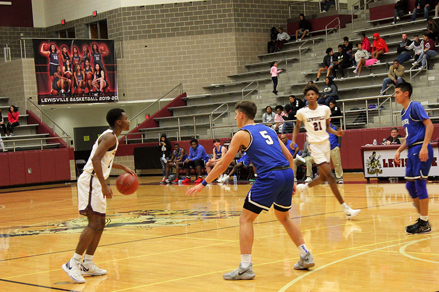 Sophomore Keyonte George (1) dribbles the ball as he looks for an open teammate during the game against R.L. Turner on Tuesday, Dec. 17.