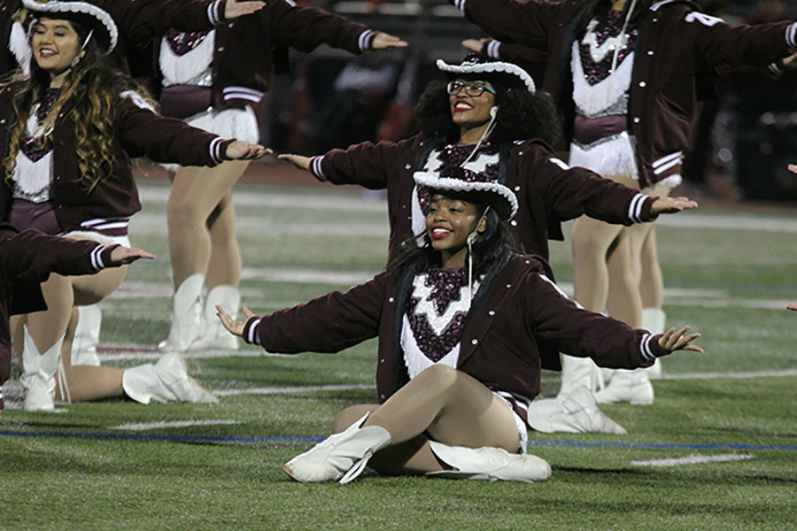Sophomore Farmerette Olivia McMillian and junior Tiara Trail pose after the halftime performance.