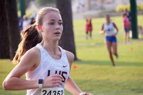 Sophomore girls varsity runner Trinity Trotter races to catch up with first place at the Marcus Invitational on Friday, Sept. 18. Trotter won the varsity girls' division with a time of 11:31.86.