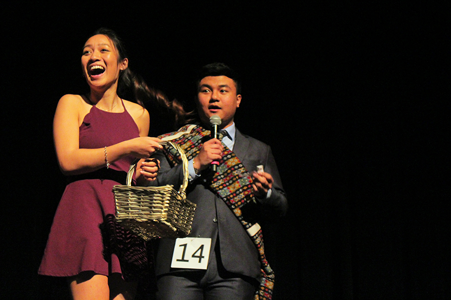 During the question and answer, seniors Maritoni Songco and James Thang laugh at an audience member's response.