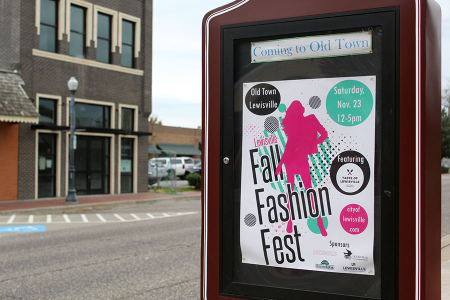 An advertisement for the Fall Fashion Fest is displayed in Old Town Lewisville.