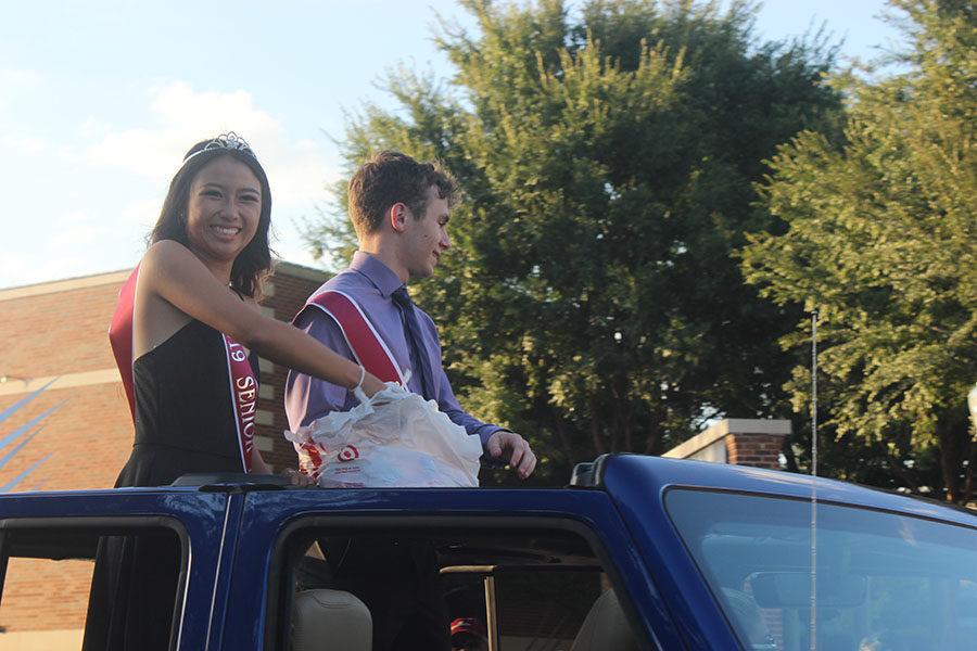 Senior princess Tara Truong rides in the homecoming parade with senior prince Nick Long.