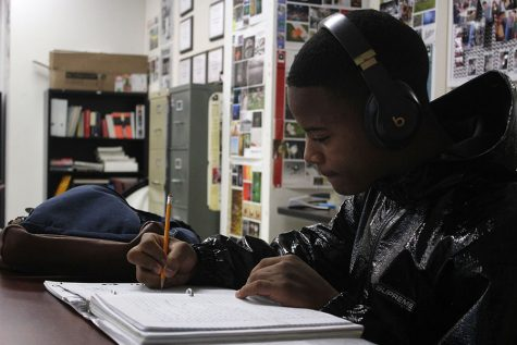 Junior Keith Coleman focuses on writing lyrics while listening to music.