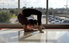 Sophomore contortionist Kiera Conner focuses on balancing on her elbows.