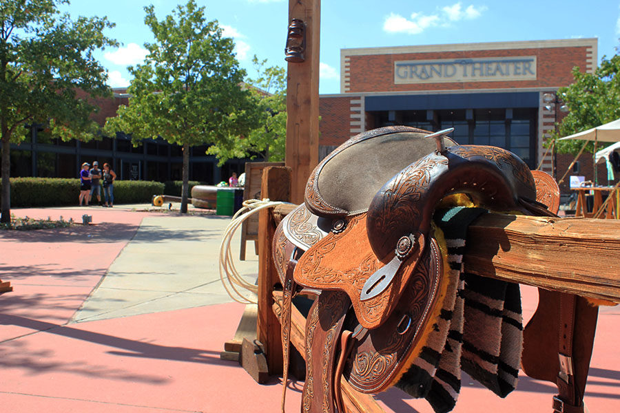 A prop from the Legends of Texas Gunfighters performance sits in front of the MCL Grand Theater.