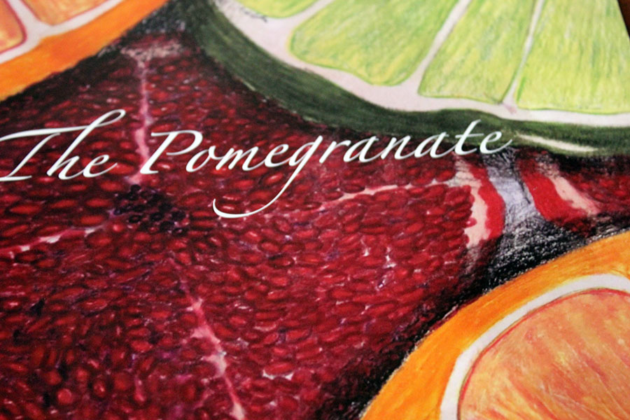 One of the covers of The Pomegranate magazine from previous years is displayed.